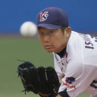 Steady work: Swallows left-hander Masanori Ishikawa delivers a pitch against the BayStars on Saturday at Jingu Stadium. Tokyo Yakult defeated Yokohama 4-1. | KYODO PHOTO