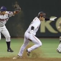Thieves never prosper: Yomiuri's Hisayoshi Chono steals second base during the Giants' 2-1 defeat to the Swallows at Tokyo Dome on Friday night. | KYODO