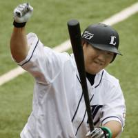 Simply the best: The Lions' Takeya Nakamura, who leads Japanese baseball with 26 home runs, pumps his fist after bashing the first of two homers in the first inning of Game 2 of the All-Star Series on Saturday in Chiba. | KYODO PHOTO