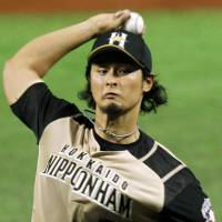 Close but no cigar: Pitcher Yu Darvish and the Fighters drop a 3-2 game against the first-place Hawks in Pacific League action on Saturday. | KYODO PHOTO