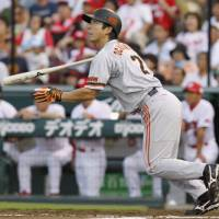 Key hit: Giants slugger Michihiro Ogasawara belts a two-run double in the first inning against the Carp at Mazda Stadium on Saturday. Yomiuri defeated Hiroshima 5-2. | KYODO PHOTO