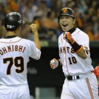 Shinnosuke Abe celebrates after hitting a three-run homer in the fifth inning of the Yomiuri Giants' game against the Hiroshima Carp. | KYODO PHOTO