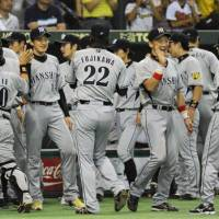 Thrill of victory: The Hanshin Tigers celebrate their 2-1 win over the rival Yomiuri Giants on Wednesday at Tokyo Dome. | KYODO