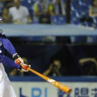 What a night: The Dragons' Ryosuke Hirata hits a three-run homer during the sixth inning against the Swallows. | KYODO PHOTO