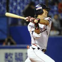 Off the mark: Yomiuri's Josh Fields hits his first home run in Japan during the Giants' 4-0 win over the Dragons on Sunday. | KYODO PHOTO