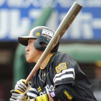 Playoff pass: Seiichi Uchikawa breaks open a tie in the top of the ninth to lead the Hawks past the Eagles on Sunday. | KYODO