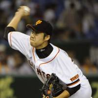 Positive start: Giants hurler Shun Tono toils on the mound in the series opener against the Carp on Friday at Tokyo Dome. Yomiuri erupted for seven runs in the eighth inning and beat Hiroshima 9-3. | KYODO PHOTOS