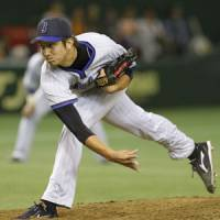 Memorable night: BayStars pitcher Yuki Kuniyoshi holds the Giants to six hits and one unearned run in seven innings on Tuesday at Tokyo Dome. Yokohama beat Yomiuri 4-1. | KYODO