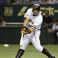 Big night: Giants star Shinnosuke Abe, seen stroking an RBI single in the first inning, drives in five runs against the BayStars on Thursday at Tokyo Dome. Yomiuri defeated Yokohama 8-2. | KYODO PHOTO