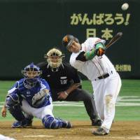 Dragon slayer: Yomiuri's Alex Ramirez hits a three-run homer against the Dragons on Sunday afternoon. | KYODO