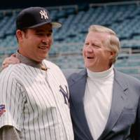 Moment in time: New York Yankees owner George Steinbrenner welcomes Hideki Irabu to Yankee Stadium in this May 30, 1997, photo. Steinbrenner would later regret signing the Japanese star to a lucrative contract.