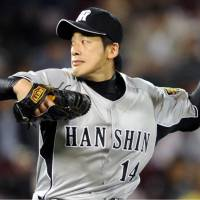 Here it comes: Tigers southpaw Atsushi Nomi fires a pitch in Saturday's game against the Carp at Mazda Stadium. Hanshin won 7-1. | KYODO PHOTO