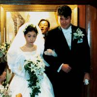 Happier times: Hideki Irabu married wife Kyonsu on Jan. 14, 1997. She and their two children left him in the final months of his life, leaving the former star despondent.