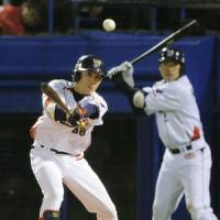 Stepping up: The Swallows' Ryosuke Morioka (68) went 4-for-9 in the first stage of the Central League Climax Series against the Yomiuri Giants. | KYODO