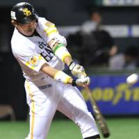 Big hit: Hawks slugger Seiichi Uchikawa bashes a two-run triple in the third inning in Game 1 of the PLCS final stage on Thursday at Yahoo Dome. Fukuoka Softbank defeated the Seibu Lions 4-2. | KYODO