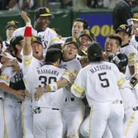 Thrilled: The Fukuoka Softbank Hawks celebrate their series-clinching victory over the Seibu Lions on Saturday at Yahoo Dome. Fukuoka beat Seibu 2-1 in 12 innings in the decisive game of the Pacific League Climax Series final stage. | KYODO PHOTO