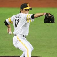 Steady lefty: The Hawks' Toshiya Sugiuchi retires 18 consecutive batters in Game 3 of the Pacific League Climax Series final stage on Saturday. | KYODO PHOTO