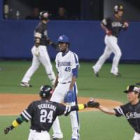 Emotional roller coaster: After the euphoria of dramatic wins in the first two games of the Japan Series, Dragons pitcher Maximo Nelson (49) and his teammates' 4-2 loss to the Hawks in Game 3 on Tuesday was a disappointment for the home fans at Nagoya Dome. | KYODO