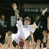 Fukuoka Softbank Hawks manager Koji Akiyama is tossed into the air as the team celebrates winning the 2011 Japan Series on Sunday. The Hawks won the deciding seventh game at Yahoo Dome in Fukuoka 3-0 to clinch their first title since 2003. | KYODO