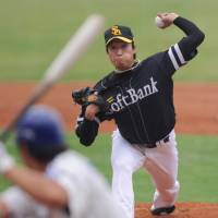 Here it comes: Fukuoka Softbank Hawks left-hander Hiroki Yamada fires a pitch to a Samsung Lions batter on Saturday in an Asia Series game in Taichung, Taiwan. The Hawks won 9-0. | KYODO PHOTO