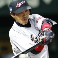 All about concentration: Japan designated hitter Seiichi Uchikawa strokes a fifth-inning RBI single against China in their WBC first-round game on Sunday. | AP