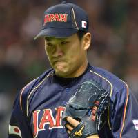 Short circuit: Starting pitcher Masahiro Tanaka lasted only two innings of Japan's World Baseball Classic-opening 5-3 win over Brazil on Saturday. | AFP-JIJI