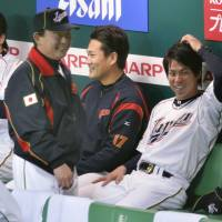 A time for everything: Smiles fill the dugout during Japan's World Baseball Classic game on Sunday against China. Japan faces Cuba on Wednesday as the teams renew their heated rivalry. | KYODO