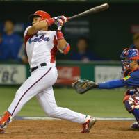 Offensive showcase: Cuba's Frederich Cepeda smacks a sixth-inning double against Taiwan in a second-round Pool 1 game in the World Baseball Classic on Saturday at Tokyo Dome. Cuba defeated Taiwan 14-0. | AFP-JIJI