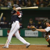 Act of mercy: Hayato Sakamoto hits a grand slam in the seventh inning of Japan's 16-4 win over the Netherlands at Tokyo Dome on Sunday night. | AFP-JIJI