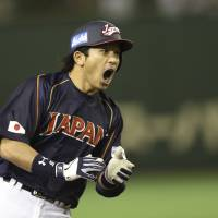 Keep it coming: Nobuhiro Matsuda shouts as he rounds the bases after hitting a two-run homer in the second inning of Japan's 16-4 win over the Netherlands on Sunday night. | AP