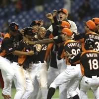 Dutch shock Cuba to make WBC semifinals
