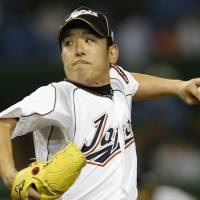 Got the job done: Japan starter Kenji Otonari, tossing a first-inning pitch, throws three innings of one-run ball against the Netherlands on Tuesday in their World Baseball Classic second-round game at Tokyo Dome. Otonari earned the win in Japan's 10-6 triumph. | AP