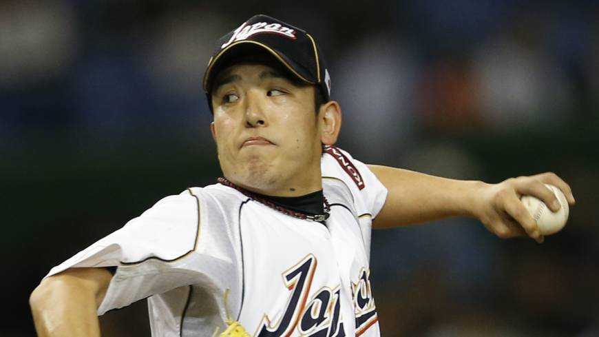 Got the job done: Japan starter Kenji Otonari, tossing a first-inning pitch, throws three innings of one-run ball against the Netherlands on Tuesday in their World Baseball Classic second-round game at Tokyo Dome. Otonari earned the win in Japan's 10-6 triumph.