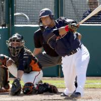 Mission accomplished: Japan's Sho Nakata clubs a run-scoring triple in the fourth inning against the San Francisco Giants on Thursday in Scottsdale, Arizona. Japan, playing a tuneup game before the World Baseball Classic semifinals, beat San Francisco 6-3. | KYODO