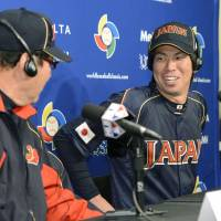 Testing the waters: Japan pitcher Kenta Maeda (right) and manager Koji Yamamoto share a joke at a news conference in San Francisco on Saturday. | KYODO