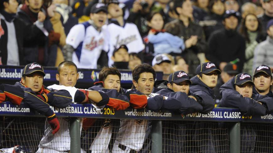 Disappointment: Japan players watch the action on the field in the sixth inning against Puerto Rico on Sunday in San Francisco.