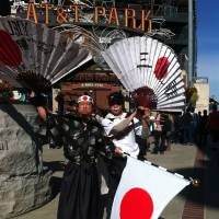 Samurai spirit: Japan supporter Shinjiro Suzuki (left) shows his colors before Sunday's semifinal against Puerto Rico in San Francisco. | KAZ NAGATSUKA