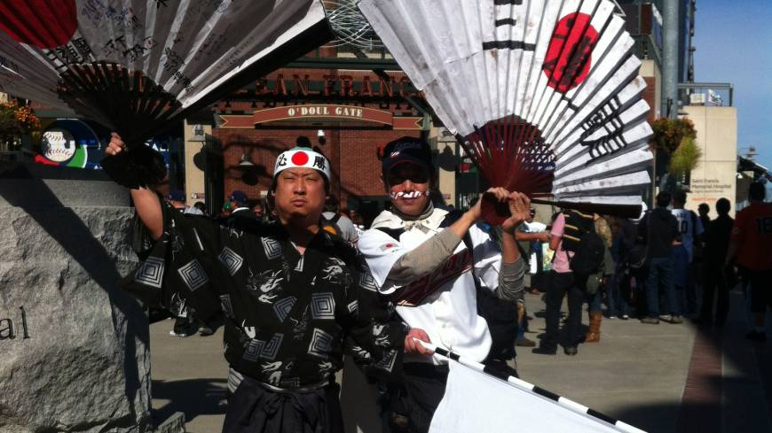 Samurai spirit: Japan supporter Shinjiro Suzuki (left) shows his colors before Sunday's semifinal against Puerto Rico in San Francisco.