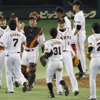 Defending champion Giants usher in new season with victory over Carp