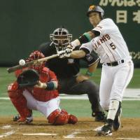 Early advantage: The Giants' Jose Lopez smacks a solo home run in the third inning. | KYODO