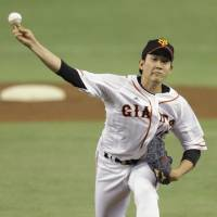 Effective outing: Giants starter Tomoyuki Sugano fans nine batters in seven innings in his Yomiuri Giants debut on Saturday against the Hiroshima Carp at Tokyo Dome. The game ended in a 1-1 tie. | KYODO