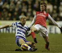 Reading's Brynjar Gunnarsson (left) vies for the ball with Arsenal's Alexander Hleb in Premier League action on Monday night at Jadeski Stadium. Arsenal won 3-1. | AP PHOTO