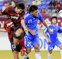 Heads I win: Kashima Antlers forward Yuzo Tashiro heads in a goal in the first half of Asian Champions League first round match against Krung Thai Bank of Thailand on Wednesday at Kashima Stadium. Antlers won 8-1. | KYODO PHOTO