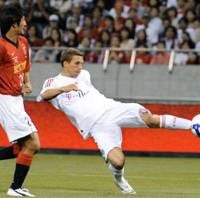 Hat trick: Bayern Munich forward Lukas Podolski scores his third goal of the match and the fourth by the German League side in the 62nd minutes of an international exhibition match against Urawa Reds at Saitama Stadium 2002 on Thursday. Bayern won 4-2. | KYODO PHOTO