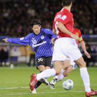 Touch of class: Masato Yamazaki scores Gamba Osaka's first goal during the second half of the Club World Cup semifinal match versus Manchester United at International Stadium Yokohama on Thursday.