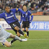 On target: Gamba Osaka forward Lucas (9) scores his second goal against second-division champion Vegalta Sendai in the Emperor's Cup semifinals on Tuesday. Gamba defeated Vegalta 2-1. | KYODO PHOTO