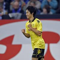 Remember the name: Shinji Kagawa celebrates his second goal for Borussia Dortmund against Schalke on Sunday. | AP PHOTO