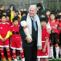Youth movement: FIFA president Sepp Blatter meets local children at the Matsushima Football Centre on Saturday. | KYODO
