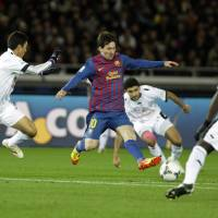 Star power: Barcelona's Lionel Messi (10) may need to play a bigger role in Sunday's Club World Cup final in the absence of injured striker David Villa. | AP