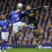 Out of action: Wigan Athletic's Ryo Miyaichi (right) is done for the season after suffering an ankle injury last weekend in the F.A. Cup quarterfinals. | AP